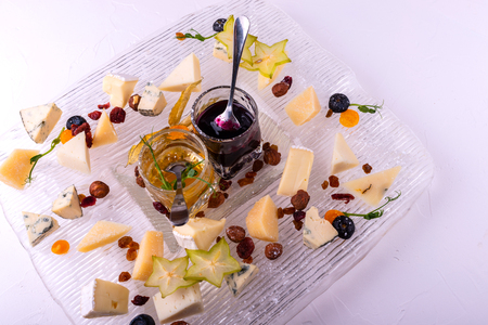 Cheese plate. Top view. Tasty cheese starter on white background. Imagens - 122387459