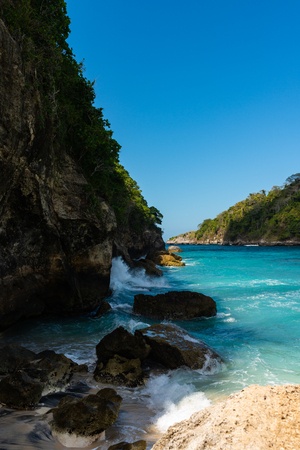 Waves beat on the rocks. Nusa Penida, Indonesia.