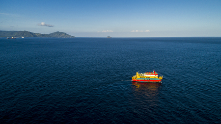 Aerial view of ferry sailing in ocean. Travel Vacation Recreation Paradise Tourism.