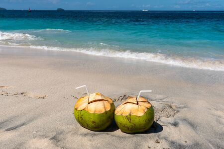 Two Fresh Coconut Cocktails on the Beautiful Beach at Sunny Day