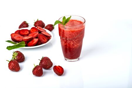 Glass of strawberry smoothie on white background.