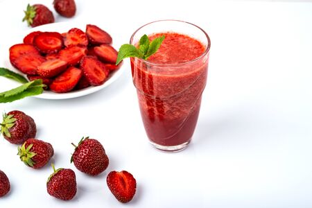 Tasty strawberry smoothie on white background. Fresh strawberry smoothie, summer drink, healthy antioxidant juice with vitamin from ripe fruits Imagens