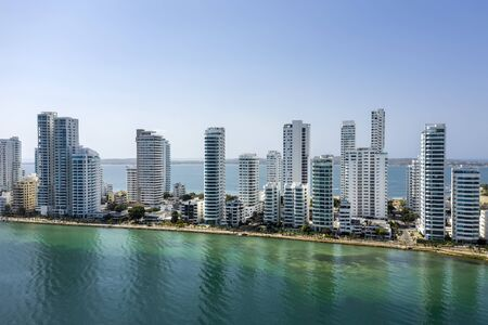 Aerial View of the hotels and tall apartment buildings near the Caribbean coast. Modern City Skyline. Banco de Imagens