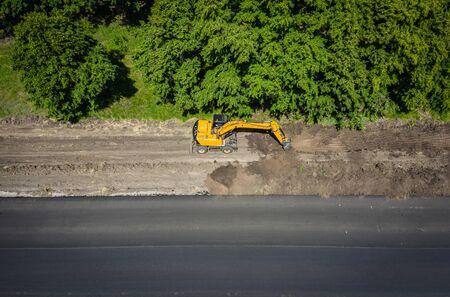 Road works. Excavator repair the road. 写真素材