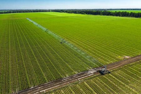 Automated irrigation system for agricultural irrigation sprinklers in cultivated agricultural landscape fields aerial view. 写真素材