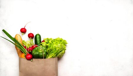 Paper bag full different healthy food products. Top view with place for text.