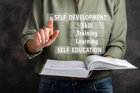 Self development, education, learnig, training, skill. Woman are clicking virtual screen. 写真素材