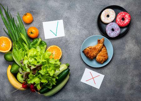 Choice between junk food and diet healthy vegan food. Top view.
