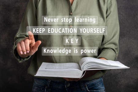 Keep educating yourself. Woman are clicking virtual screen. Banco de Imagens