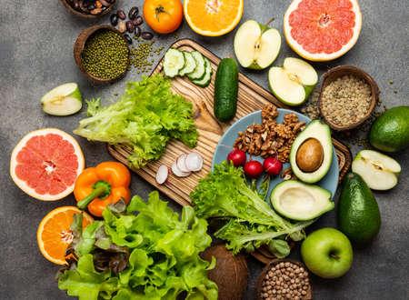 Healthy vegan diet food concept vegetables greens nuts. Top view.