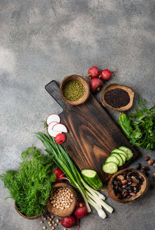 Wooden cutting board fresh ingredients for cooking vegan food