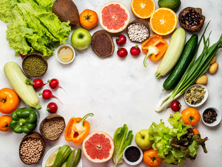 Frame of different vegetables cereals beans. Vegan healthy menu. Top view. 写真素材