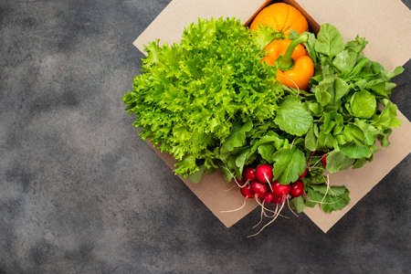 Farm food delivery. Organic vegetables in the box. Top view.