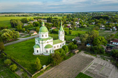 Greek Orthodox Church, religious, building XVIII century. Three Saints Church in Lemeshi, Chernigiv region, Ukraine aerial view.