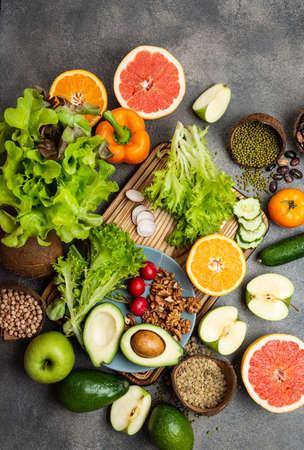 Healthy vegan diet food vegetables greens nuts cereals. Top view 写真素材