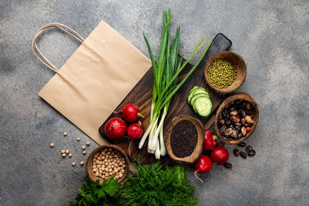 Different vegetables cereals beans and shopping paper bag