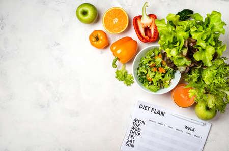Diet plan and vegetables salad juice. Top view with place for text
