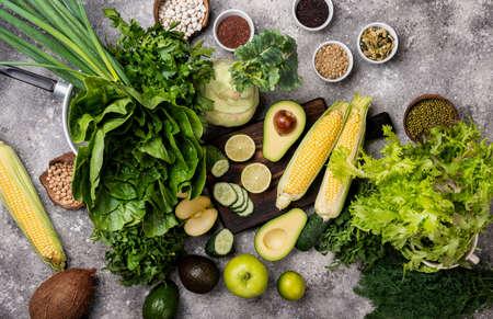 Set raw healthy food clean eating vegetables greens cereals top view. 写真素材