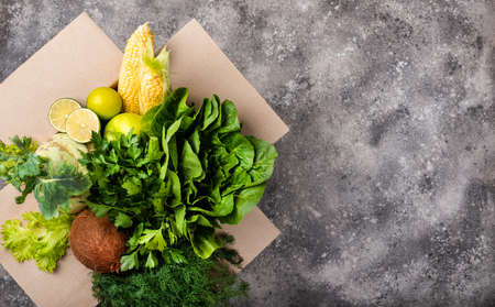Different organic fresh vegetables in box. Order and delivery food concept top view.