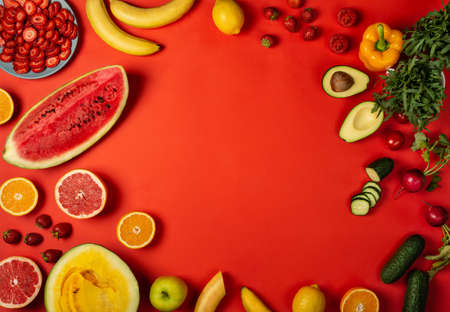 Healthy food menu from fruits and vegetables on the red background. Top view with copy space Banco de Imagens