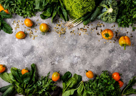Frame from different vegetables and greens. Top view with copy space Banco de Imagens