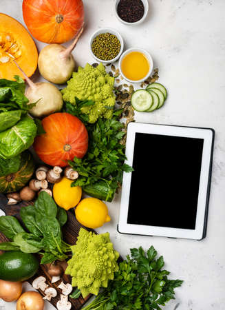 Tablet computer with ingredients for cooking healthy food