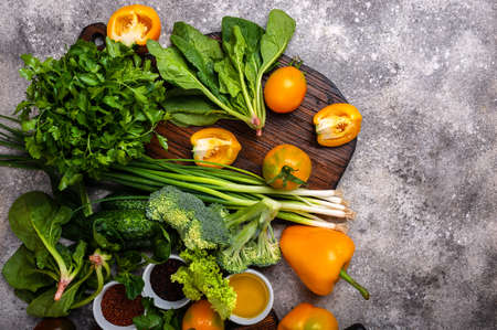 Ingredients for cooking healthy food with chopping board on the table