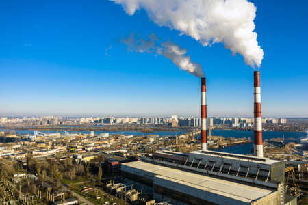 Garbage incineration plant. Waste incinerator plant with smoking smokestack. The problem of environmental pollution by factories aerial view