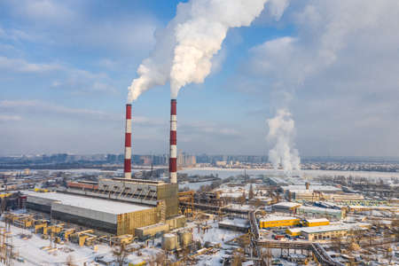 Garbage incineration plant. Environmental pollution within the city at the winter aerial view. Zdjęcie Seryjne