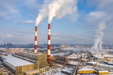 Garbage incineration plant in the big city at the winter aerial panorama view.