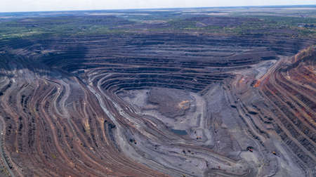Open Iron Ore Quarry in summer day Aerial Top View