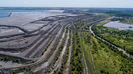 Tailings dump are the materials left over after the process of separating the valuable fraction from the uneconomic fraction gangue of an ore aerial view.