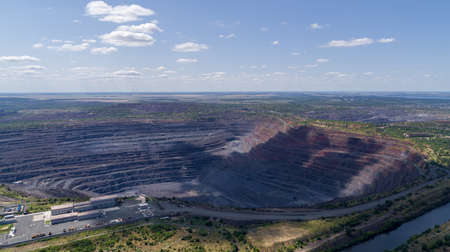 Open pit iron ore quarry panoramic industrial landscape aerial view