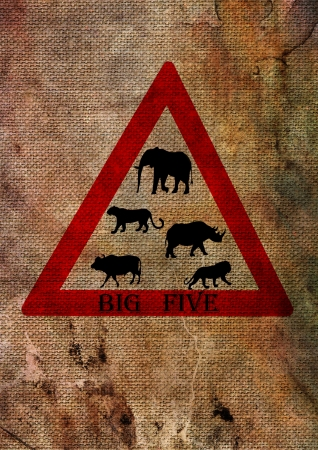 Wildlife big five from South Africa on road sign triangle, red on textured background photo