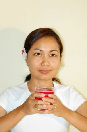 Women holding aroma candle photo