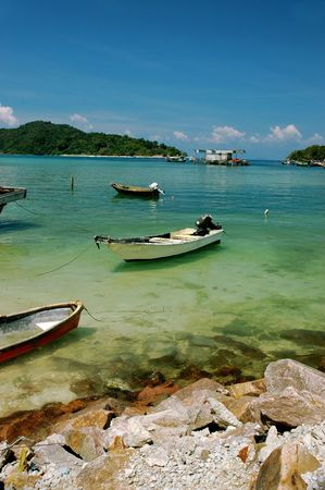 Paradise - boats on the clear water and blue sky photo