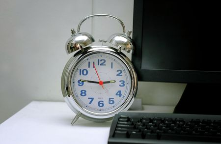 Clock and computer - working hours photo