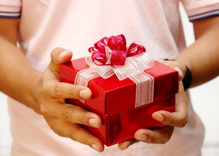 Men holding a present Stock Photo - 296112