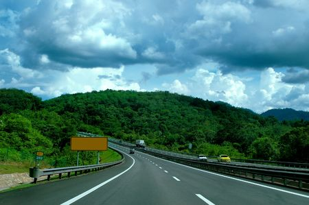 the carriageway: Highway at cloudy weather Stock Photo