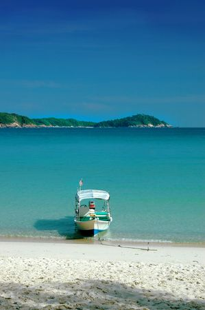 Small boat - beach scenery Stock Photo - 374293