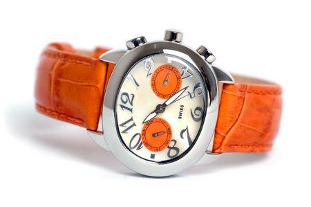 stell: Orange wristwatch in white background
