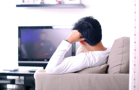 lcd tv: Man watching movies