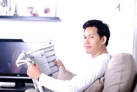 Man reading a newpaper Stock Photo - 877606