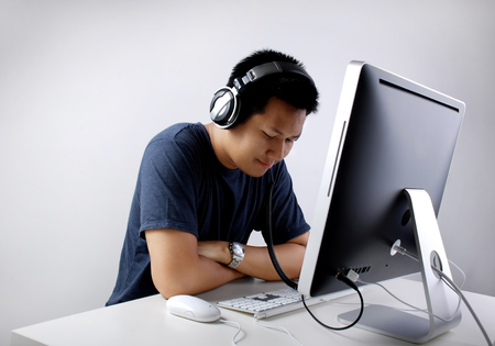 Man listening to music at the office Stock Photo