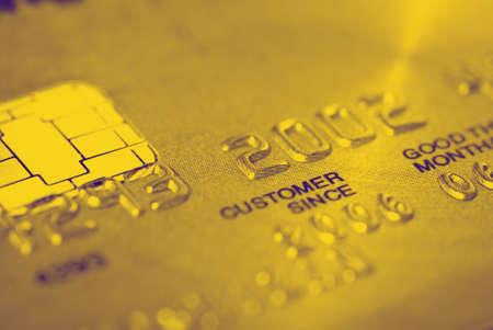 Gold credit card (closeup) photo
