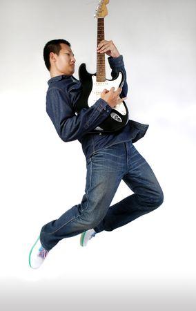 air guitar: Air born guitarist Stock Photo