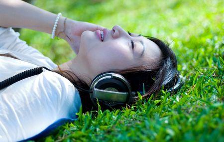Women enjoy music at the garden Stock Photo