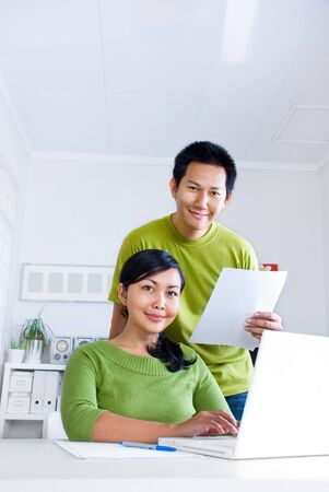 office romance: Couple working together