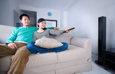 speakers: Couple watching television together