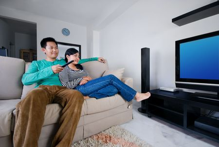 Couple watching television together  photo